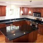 Kitchen with dark counter tops