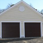 Attached 2 bay Garage brown doors