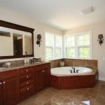Spacious bathroom with corner Jacuzzi tub