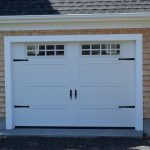 White garage door with black handles