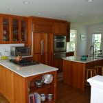 Kitchen with wood paneled Fridge